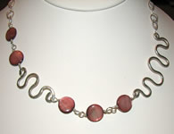 pink shell with silver squiggles necklace