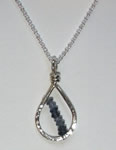 petite hand hammered sterling silver teardrop pendant with diagonal strand of iolite faceted rondelles