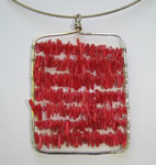 hammered sterling silver pendant with red coral chips