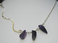 asymetrical hammered silver necklace with freeform amethyst beads