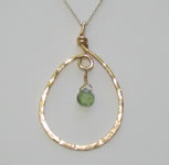 gold filled hammered teardrop pendant with green tourmaline briolette