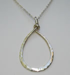 sterling silver hand forged teardrop pendant