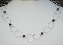 hand made large link necklace with red tiger eye accents