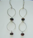 large sterling silver link earring with red tiger's eye bead in center