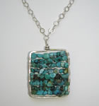 hand forged silver frame pendant with turquoise beads