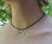 han forged sterling silver heart on black rubber cord necklace
