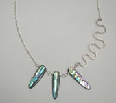 asymetrical sterling silver necklace with long paua shell beads